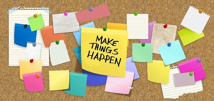"""image of a board that a bulletin board with a note that says """"Make Things Happen"""""""