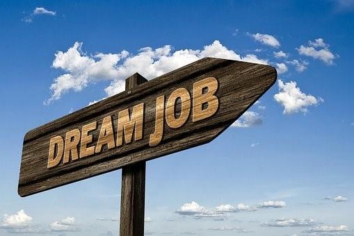 "a sign that says ""Dream Job"""